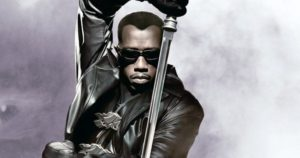 Wesley Snipes as Blade, wearing a leather jacket and holding a sword