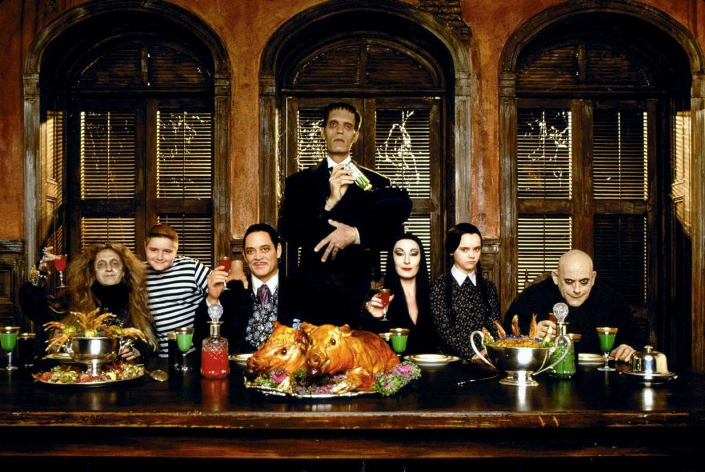 The Addams Family at a holiday table
