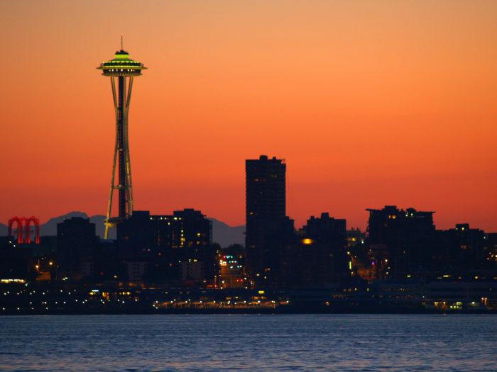 Seattle skyline against a fiery sunset