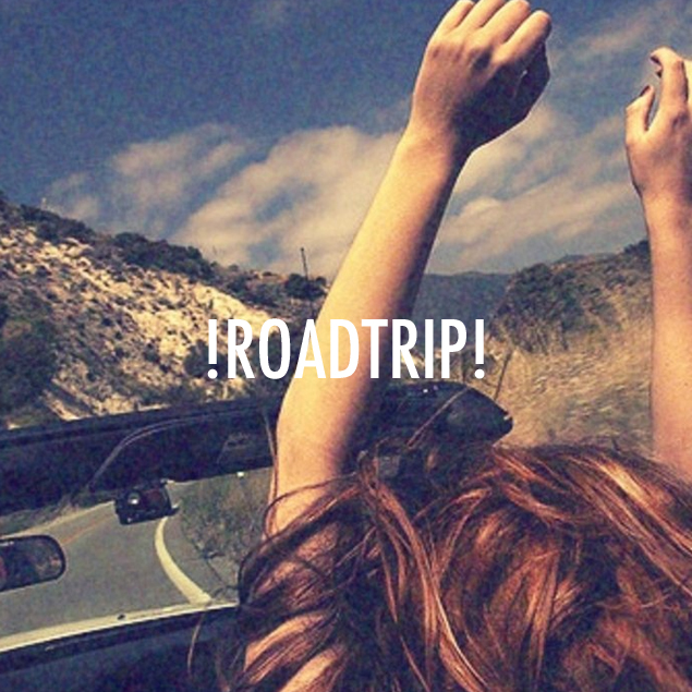 A woman in a car has her hands joyously in the air. Text over the picture sayd !Roadtrip!